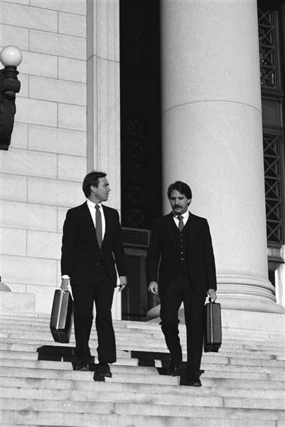two lawyer walking down court house steps